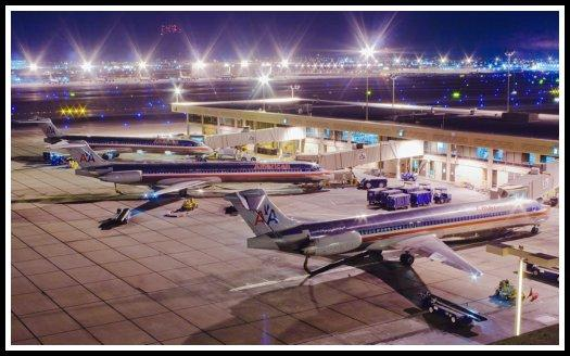 American Airlines McDonell Douglas aircraft being serviced at night